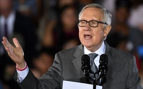 U.S. Senate Minority Leader Harry Reid (D-NV) speaks at a campaign rally with U.S. President Barack Obama for Democratic presidential nominee Hillary Clinton