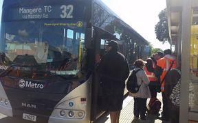 Auckland Transport staff in hi-vis vests were stationed on routes to help people find their buses.