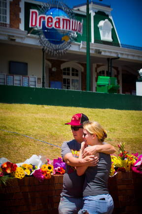 People hug outside Dreamworld after four people were killed at the Queensland theme park.