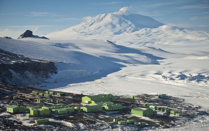 Science research base on Ross Island with Mount Erebus behind, Antarctica.