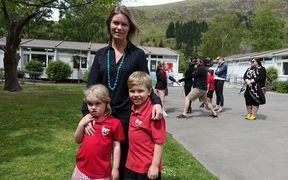 Chelsea Halliwell with her kids Georgie and Flynn, at today's announcement over the future of Redcliffs School.