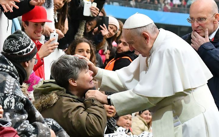 Pope Francis greets a handicapped wellwisher as he arrives at the Swedenbank Stadion in Malmo, Sweden, where he is to hold a mass on November 1, 2016.