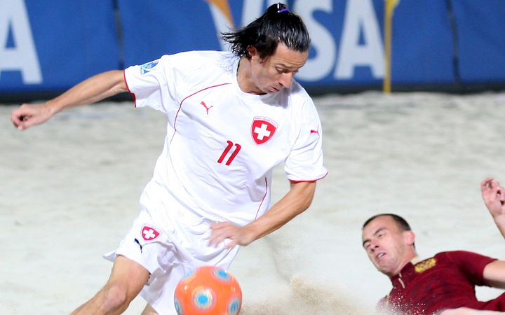Tahiti coach Angelo Schirinzi (L) in possession during the 2009 Beach Soccer World Cup.