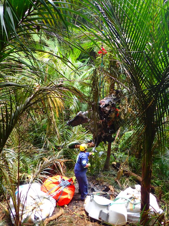 Investigators remove the wreckage of a Robinson R44 helicopter in Glenbervie forest near Whangarei.