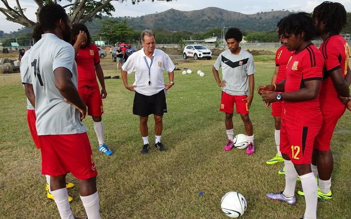 PNG coach Flemming Serritslev and players during a Kapuls training session.