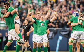 Ireland celebrate their win over the All Blacks.