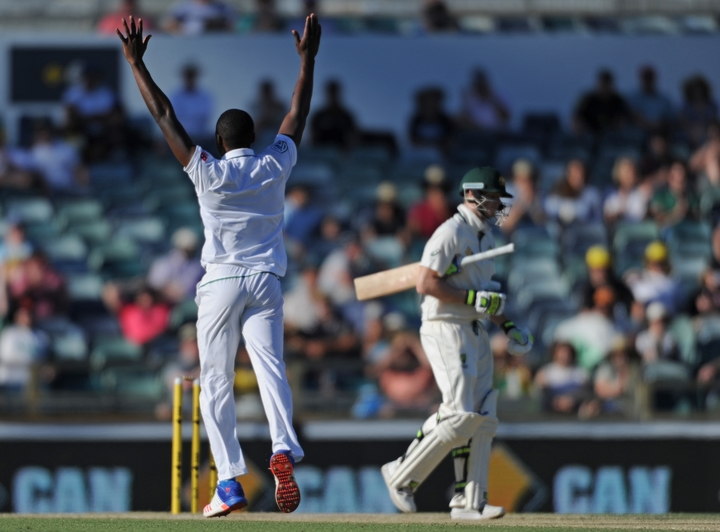 South African cricketer Kagiso Rabada celebrates the wicket of Steve Smith during their first Test against Australia