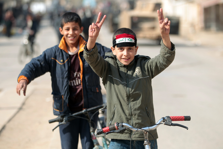 Boys from Hammam al-Alil celebrate as they return home after Iraqi forces re-took the town south of Mosul from Islamic State fighters.