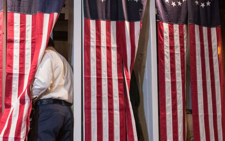 Seven voters choose their candidate at midnight on on November 8, 2016 in Dixville Notch, New Hampshire, the first voting to take place in the 2016 US presidential election.