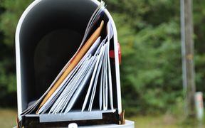 Letterbox full of mail. letterbox generic