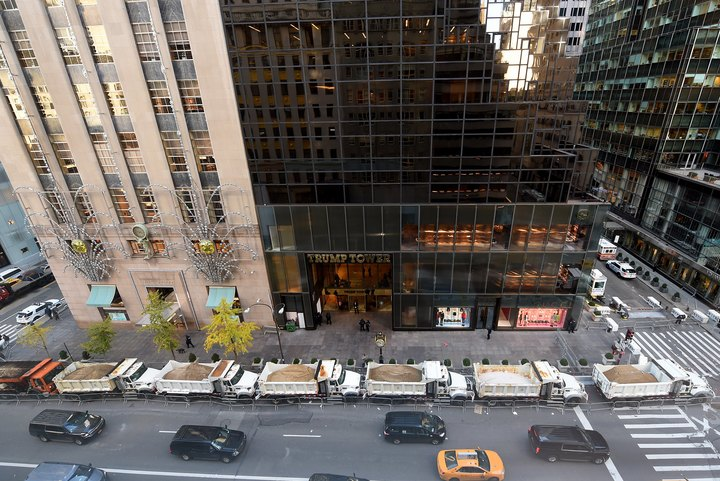 A protective barrier of sanitation department trucks parked in front of Trump Tower on 5th Avenue to provide security to President-elect Donald Trump.