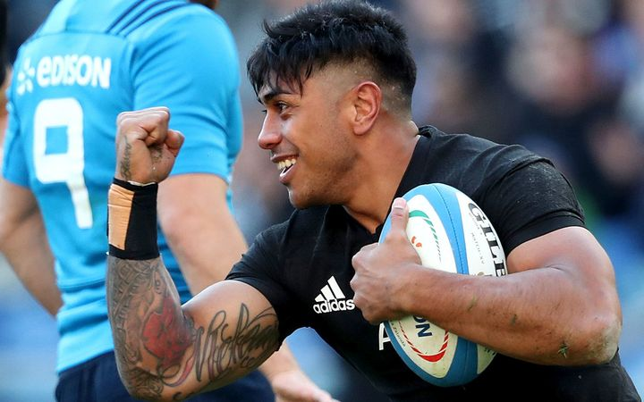 Malakai Fekitoa celebrates scoring a try against Italy.
