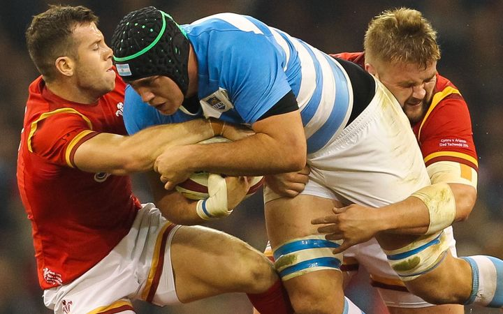 Argentina's Matías Alemanno is tackled by Wales Gareth Davies and Tomas Francis.