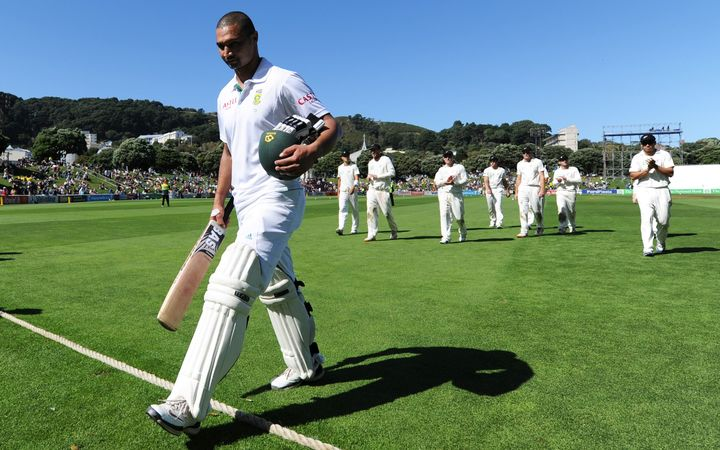 Alviro Petersen leads players off the Basin Reserve, 2012.