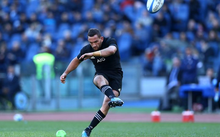 Aaron Cruden goes for goal against Italy.