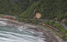 A train is trapped by landslides on the Kaikoura coast line.
