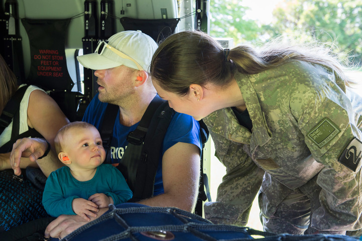 New Zealand Defence personnel help evacuees settle in for their journey away from quake-stricken Kaikoura.