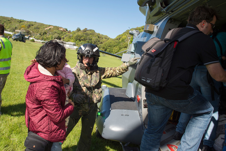 Parents and children are evacuated from Kaikoura by the New Zealand Defence Force.