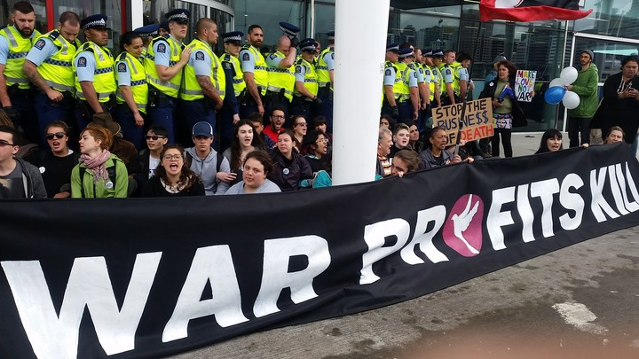 Protesters outside the annual conference of the New Zealand Defence Industry Association.