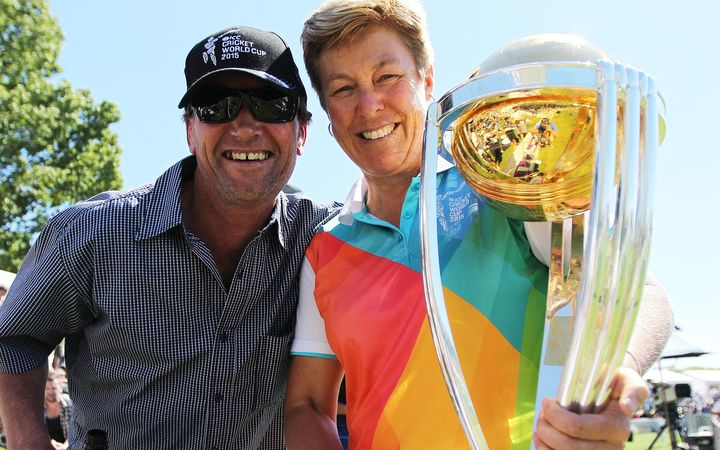 Debbie Hockley, is New Zealand Cricket's first female president.  Pictured here at Hagley Oval in 2014 holding the Cricket World Cup with a fan.