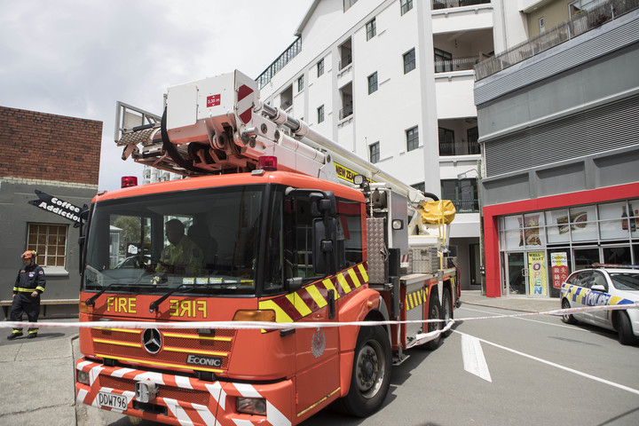 Emergency service outside Tennyson Apartments on Tennyson St, Wellington. The apartments have been evacuated because of structural damage.
