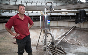 Simon Mackle stands inside his milking shed which is now back operational, but with no water to clean the shed, and no road out of Kaikoura still, all milk is being tipped down the drain.