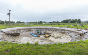 The effluent pond at Simon Mackle's dairy farm is being used to dump milk that is unable to be shipped out of the dairy farm.