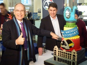 Mayor Len Brown (left) and Auckland Transport chair Lester Levy cutting Britomart Transport Centre's 10th birthday cake.