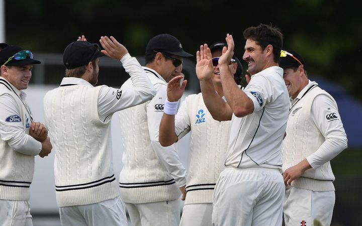 Black Caps celebrate Colin de Grandhomme taking a wicket.