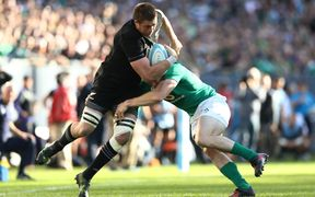 All Blacks player Liam Squire is tackled by Ireland player Andrew Trimble at Soldier Field on 5 November.