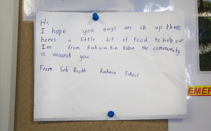 A handwritten note that came with some goods donated to Takahanga Marae.