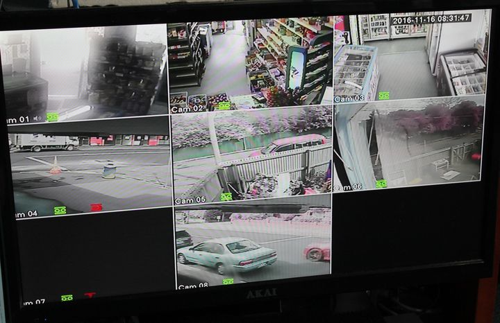 A photo of several different screens. These show CCTV footage of Kamlesh Patel's store taken from security cameras