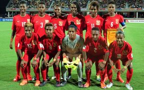 The PNG Under 20 women's team line-up before their World Cup opener against Brazil.