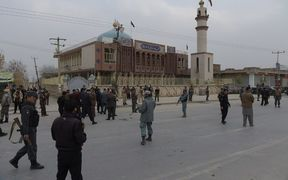 Afghan security personnel gather after a suicide blast at a Shiite mosque in Kabul.