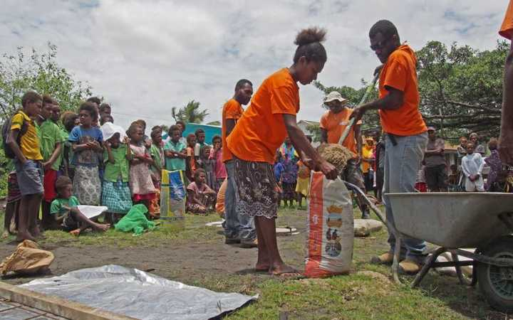 Tanna villagers learn how to build a latrine