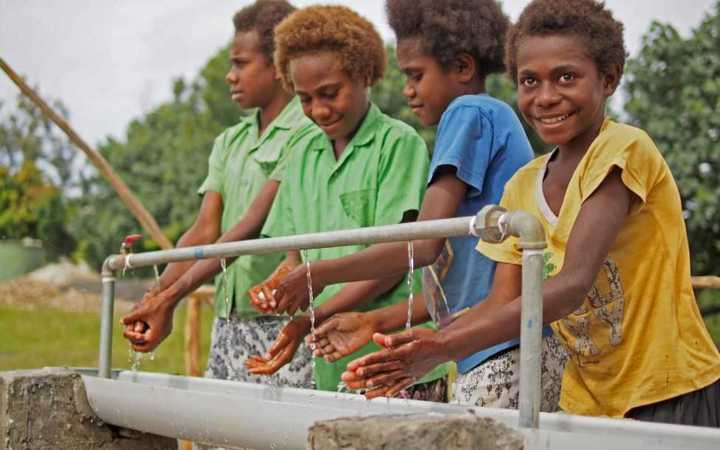 Ni-Vanuatu girls use a new handwashing station