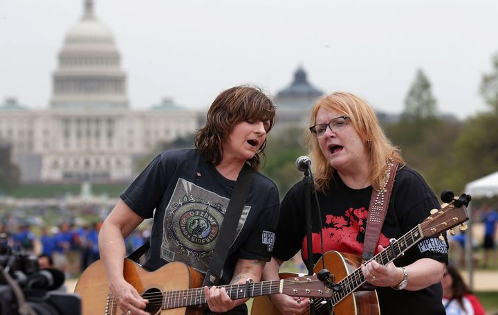 Amy Ray, left, and Emily Saliers of The Indigo Girls perform in the National Mall in Washington DC, US.