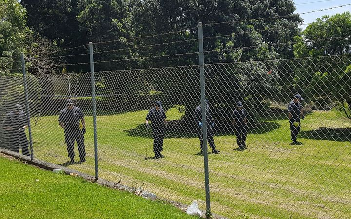 Police search the Mangere Bridge park where the baby's body was found.
