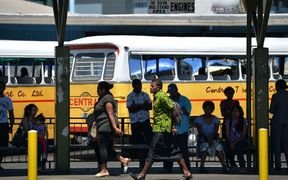 This photo taken on September 15, 2014 shows travellers at the central bus station as Fiji gets ready for the upcoming elections in Suva, the capital of Fiji.