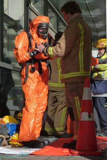 Emergency staff had to wear protective clothing.