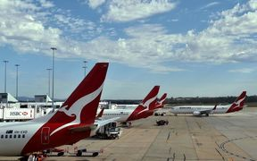 February 23, 2015 shows a Qantas plane leaving a departure gate at Melbourne International Airport.