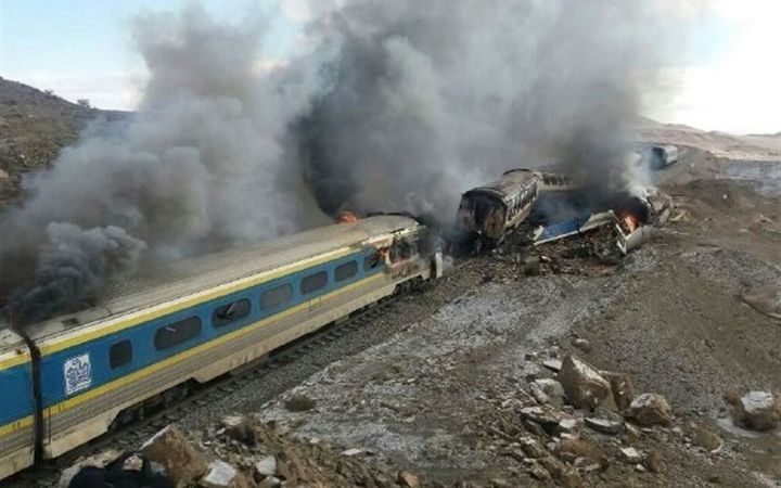 Two trains burn after a collision which killed 40 people in Iran.