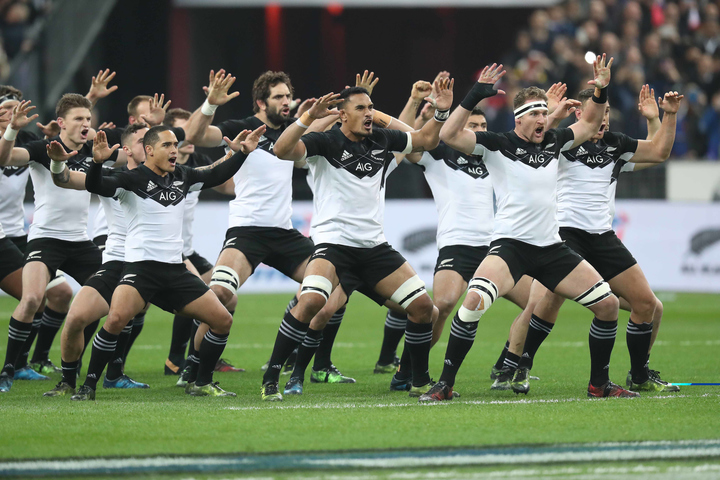 The All Blacks perform the Haka in their new jerseys in the Test against France in Paris.