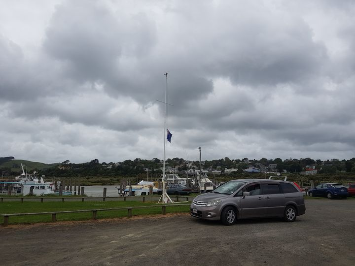 The flag at the Kaipara boat and fishing club being flown at half-mast.
