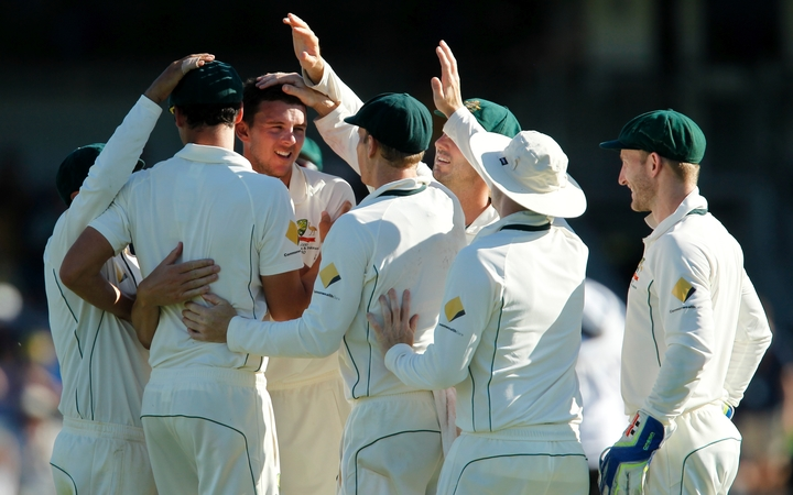 The Australian cricketers celebrate a Josh Hazlewood wicket during their Test series against South Africa