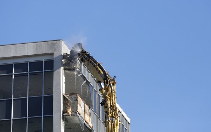 A large crane begins the demolition of the office block at 61 Molesworth St damaged in the Kaikōura earthquake.