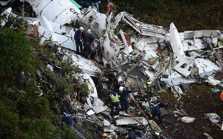 Rescuers search for survivors in the wreckage of a charter plane carrying Brazil's Chapecoense Real football team.