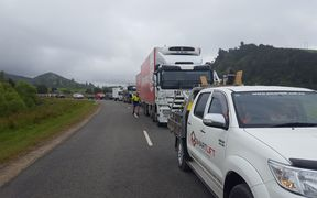 Cars and trucks line up as drivers wait for the all clear to go through the inland route to Kaikoura 30 November.