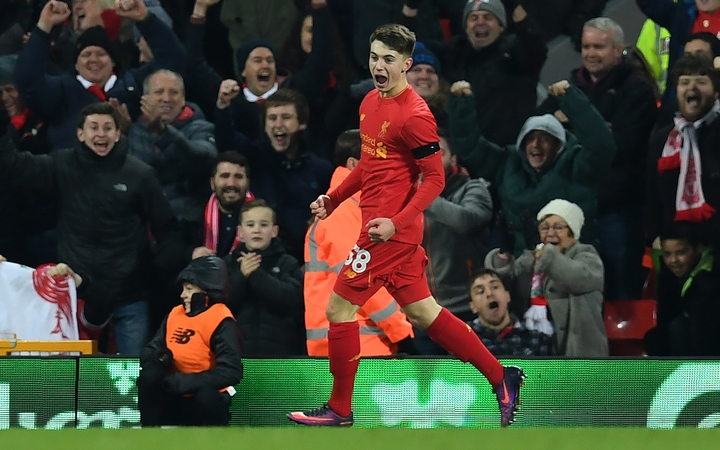 Ben Woodburn celebrates his goal for Liverpool, which made him the club's youngest ever goalscorer