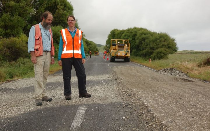 GNS scientists Russ Van Dissen and Nicola Litchfield show how State Highway 1 at Ward has been shunted sideways in the quake - the centre line is misaligned.